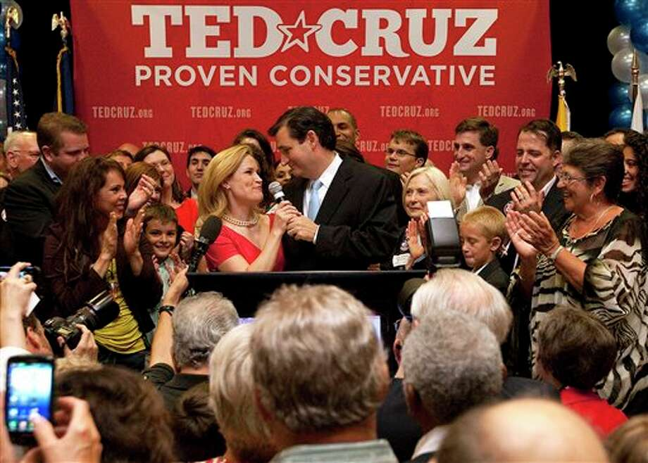 U.S. Senate candidate Ted Cruz thanks his wife, Heidi, in front of a cheerful crowd after he defeated Republican rival, Lt. Gov. David Dewhurst, in a runoff election for GOP nomination for the U.S. Senate seat vacated by the retiring Kay Bailey Hutchison, Tuesday, July 31, 2012, in Houston. (AP Photo/Houston Chronicle, Johnny Hanson) MANDATORY CREDIT Photo: Johnny Hanson / Houston Chronicle