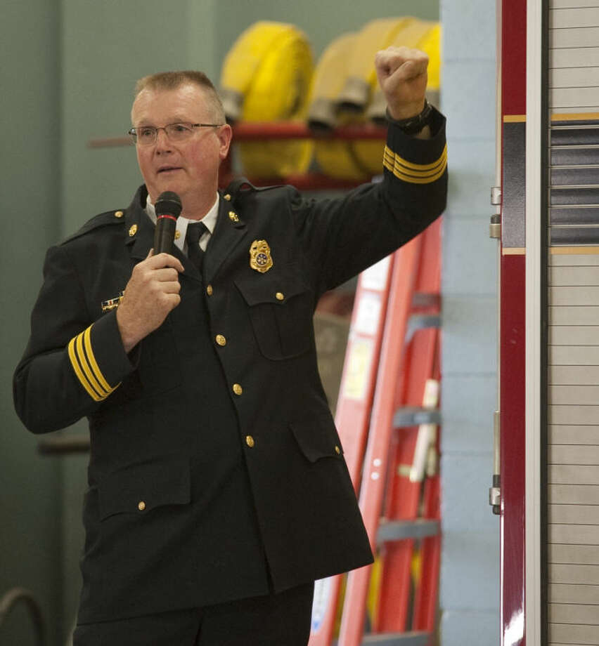 Midland Fire Battalion Chief Vince Hancock talks about remembering when firefighters actually stood on the back of the fire truck and had to hang on enroute to a fire during his retirement ceremony Friday. Tim Fischer\Reporter-Telegram Photo: Tim Fischer