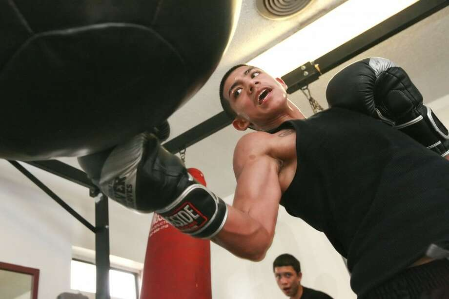 Michael Ductchover works out with the heavy bag Friday while training at Clayton Williams Boxing Center. Dutchover will compete in the Ringside World Amateur Championships in Kansas City, Mo., beginning Wednesday. Cindeka Nealy/Reporter-Telegram Photo: Cindeka Nealy