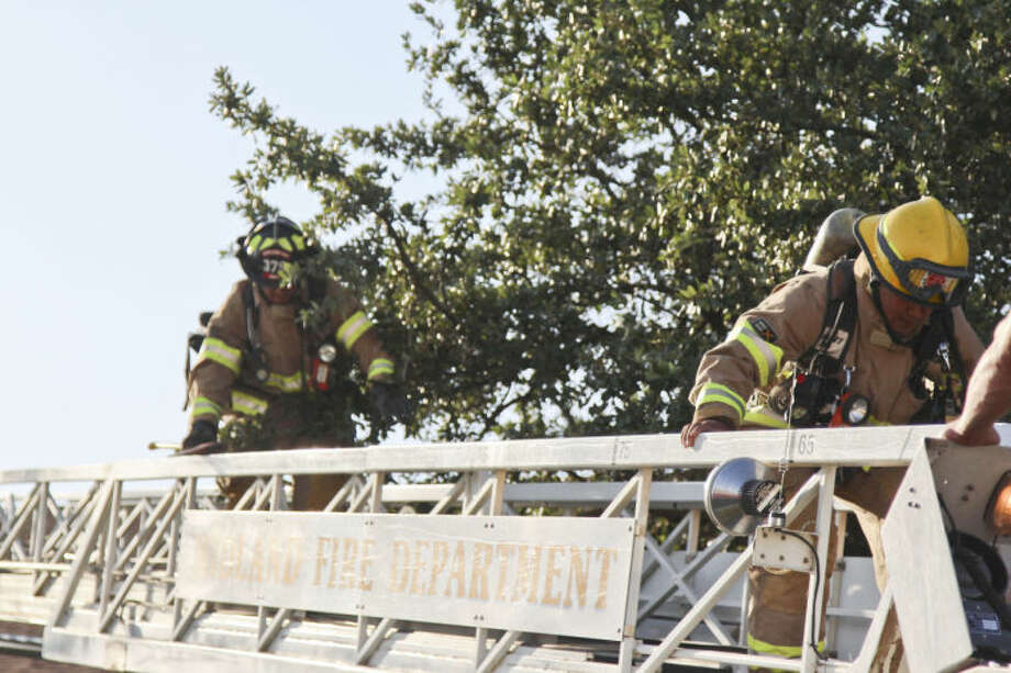 Midland firefighters work to extinguish a blaze that displaced at least two families Thursday evening at the Dakotas at Saddle Club apartment complex. Tyler White/Reporter-Telegram Photo: Tyler White