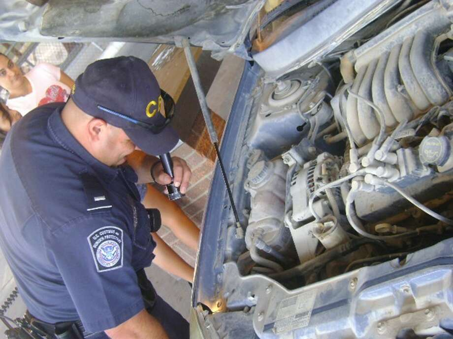 U.S. Customs and Border Protection inspects cars at the Presidio port. Photo: Courtesy Photo