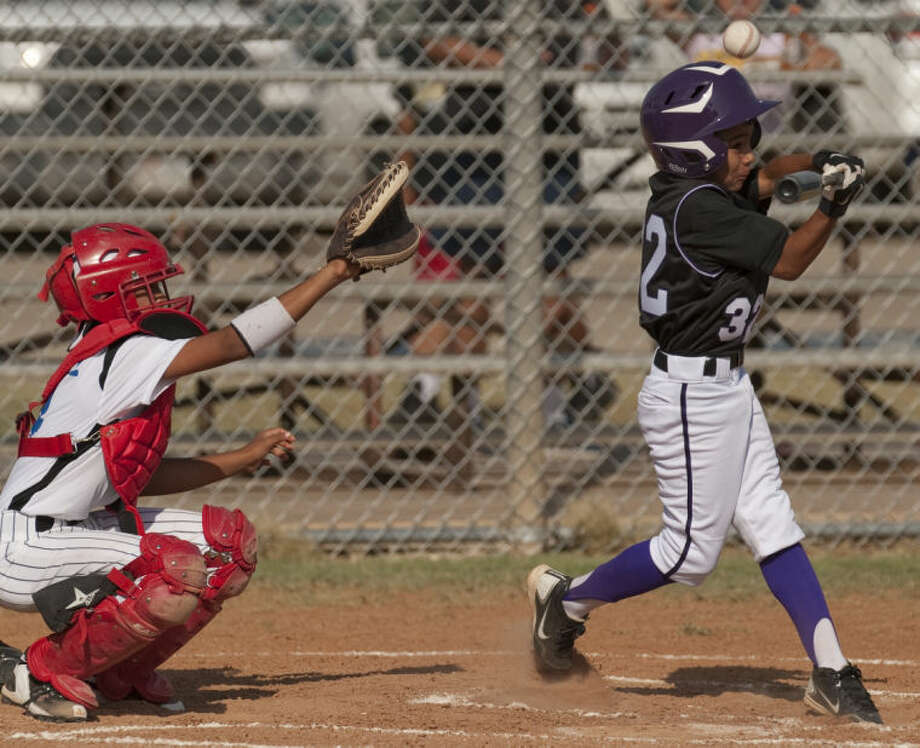 Mid City players take on Eastern during the Little League 10-11 year olds tournament at Butler Park Monday night. Tim Fischer\Reporter-Telegram Photo: Tim Fischer