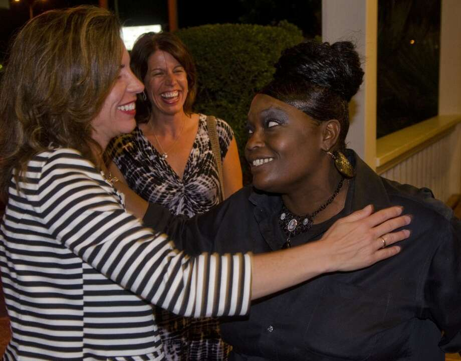 Elizabeth Leonard, left, gets a congratulatory hug from Outback waitress Kimberley Anders Tuesday night as she meets her family, including sister, Joan Byer Gudorf, behind, following her win for the 238th District Court Judge seat. Photo by Tim Fischer\ Reporter-Telegram Photo: Tim Fischer