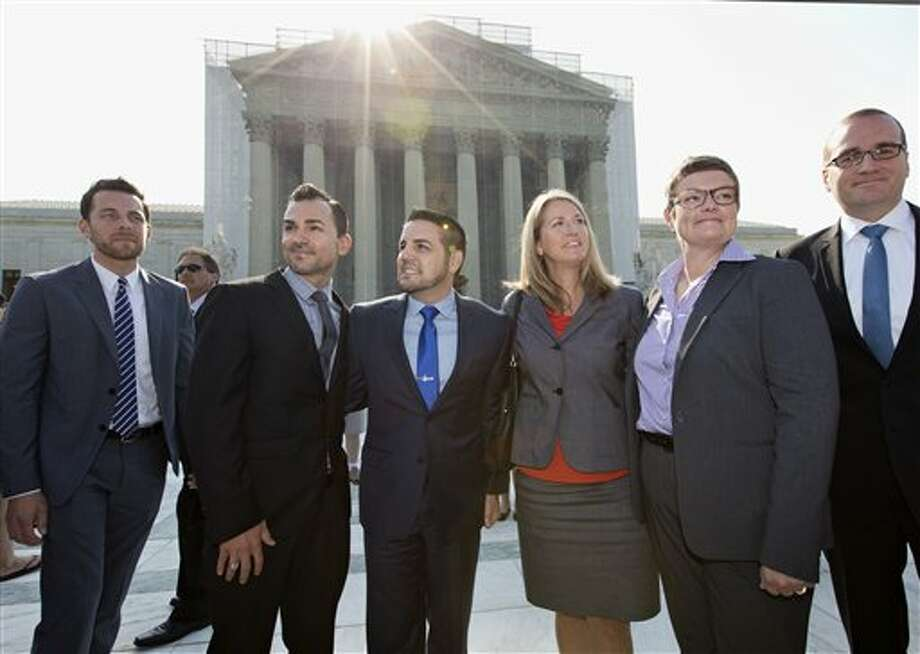 Arriving at the Supreme Court in Washington, Wednesday, June 26, 2013, on a final day for decisions in two gay marriage cases are plaintiffs in the California Proposition 8 case. From left are, Adam Umhoefer, executive director of the American Foundation for Equal Rights, plaintiffs Paul Katami, his partner Jeff Zarrillo, Sandy Stier and her partner Kris Perry, and Chad Griffin, president of the Human Rights Campaign. (AP Photo/J. Scott Applewhite) Photo: J. Scott Applewhite / AP2013
