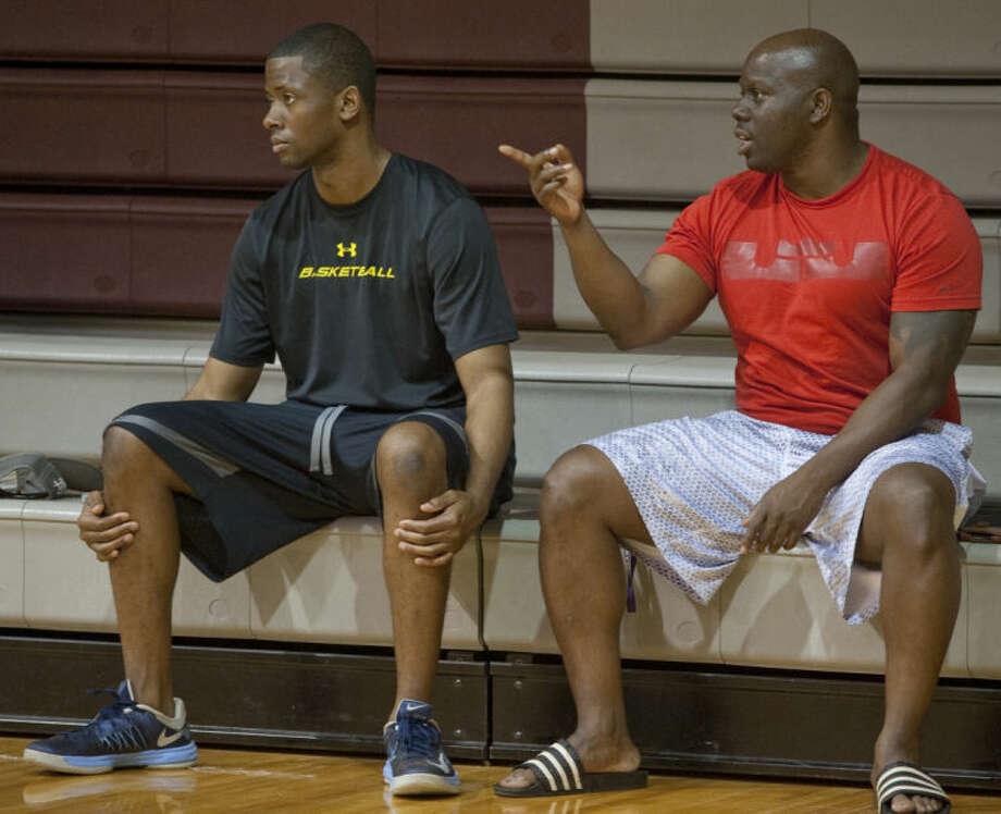 Coaches Chris Packer and Charles Tatum talk and watch players from Lee, Midland High, Midland College and the area play pickup games on June 18 at Lee High. Tim Fischer\Reporter-Telegram Photo: Tim Fischer