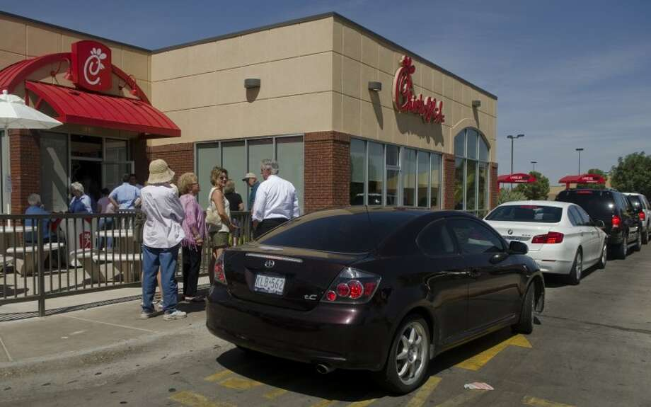 Midlanders came out Wednesday to show their support for Chick-fil-A CEO and his opinions on marriage by lining up to buy lunch or drinks at Chick-fil-A on Loop 250. Photo by Tim Fischer\ Reporter-Telegram Photo: Tim Fischer