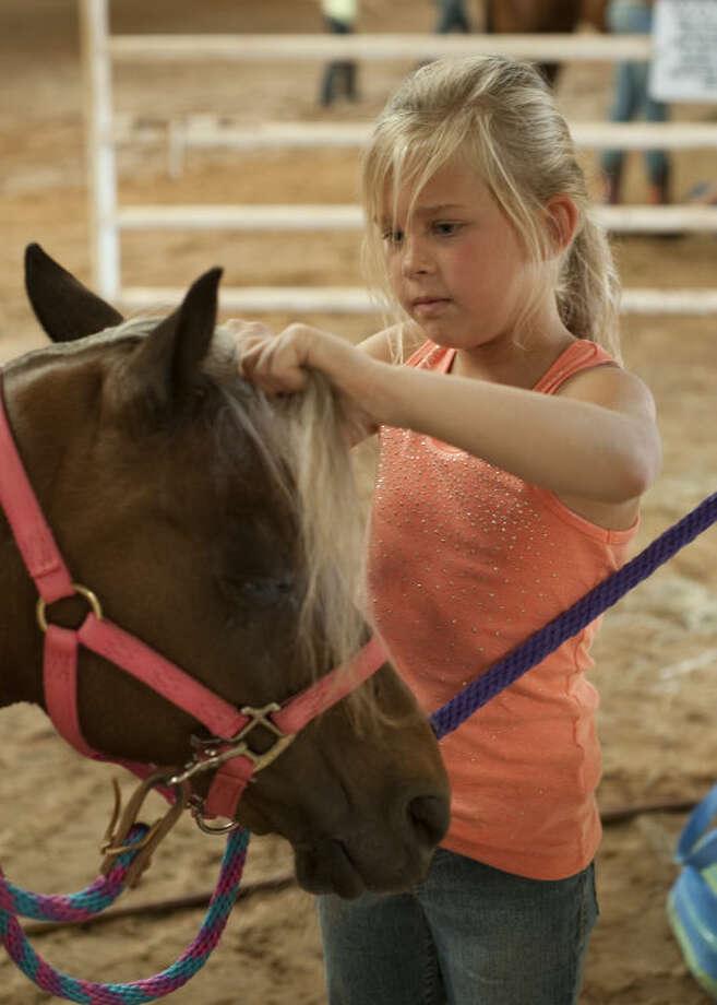 Ally Estup preps her horse at Double Diamond Equestrian Center camp. Tim Fischer\Reporter-Telegram Photo: Tim Fischer
