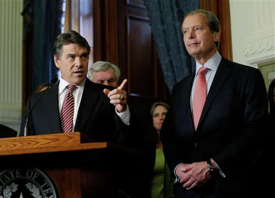 In this May 28, 2013 file photo, Lt. Gov. David Dewhurst , right, stands with Gov. Rick Perry during the signing of a water fund bill, in Austin, Texas. Now that the governor has called a special session, Dewhurst will get a chance to resurrect the anti-abortion legislation bill that failed earlier this week, but maybe not his political career. (AP Photo/Eric Gay) Photo: Eric Gay / AP