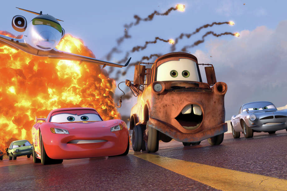 "In this film publicity image released by Disney-Pixar, animated characters Lightning McQueen, voiced by Owen Wilson, foreground left, Mater, voiced by Larry the Cable Guy, center, and Finn McMissile, voiced by Michael Caine, right, are shown in a scene from ""Cars 2."" (AP Photo/Disney/Pixar) Photo: HONS / ©Disney/Pixar.  All Rights Reserved."