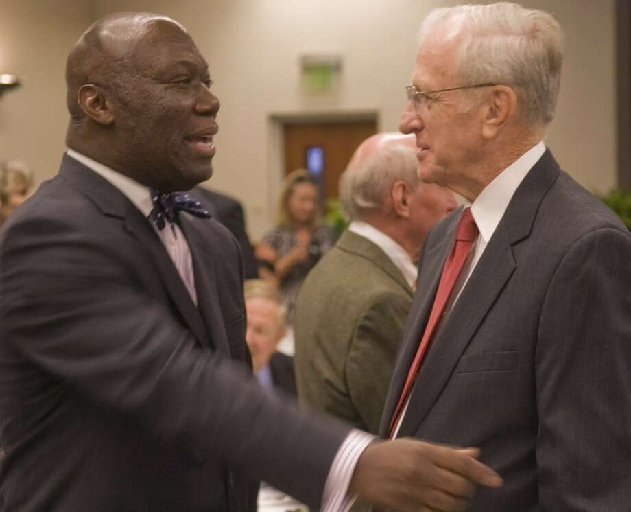 (FILE PHOTO) Lee Legacy inductee Michael Williams talks with former Midland Mayor Ernie Angelo Saturday night at the Lee Legacy Wall of Honor induction ceremony. Photo by Tim Fischer/Midland Reporter-Telegram Photo: Tim Fischer