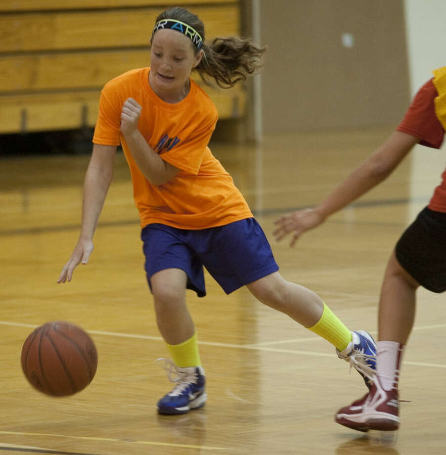 Leia Beattie dodges a player trying to knock her ball away during games at Midland College basketball camp. Tim Fischer\Reporter-Telegram Photo: Tim Fischer
