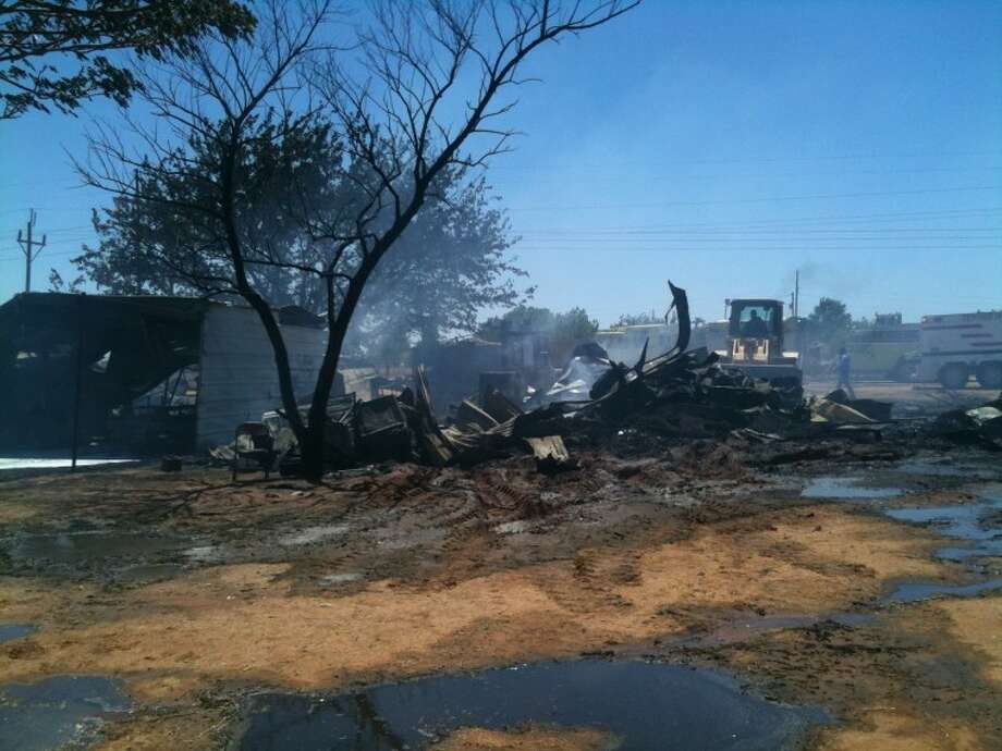 "A fire caused by three children ""playing with fire"" destroyed three homes on East County Road 136 Thursday afternoon. Photo: James Cannon/MRT Staff Writer"