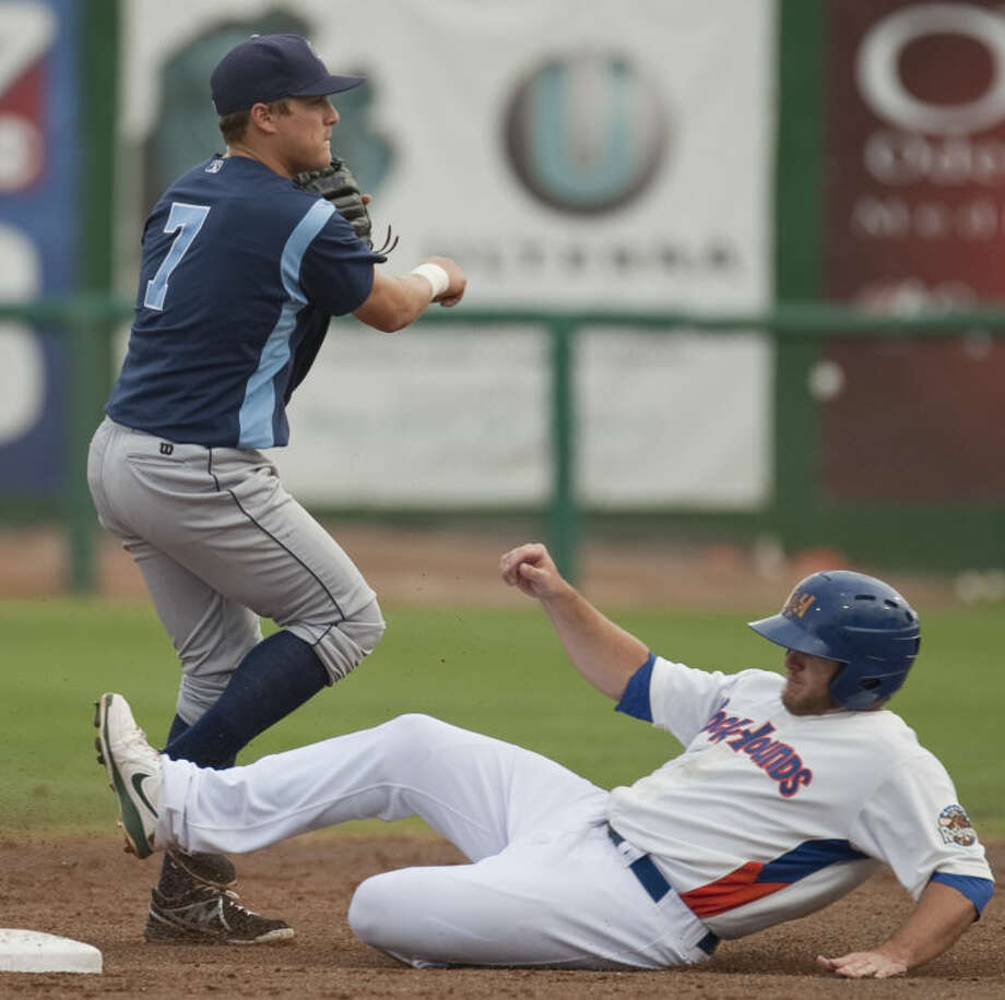 RockHounds' Max Muncy slides in too late to second as Hooks' Enrique Hernandez throws to first for the double play Monday at CitiBank Ballpark. Tim Fischer\Reporter-Telegram Photo: Tim Fischer