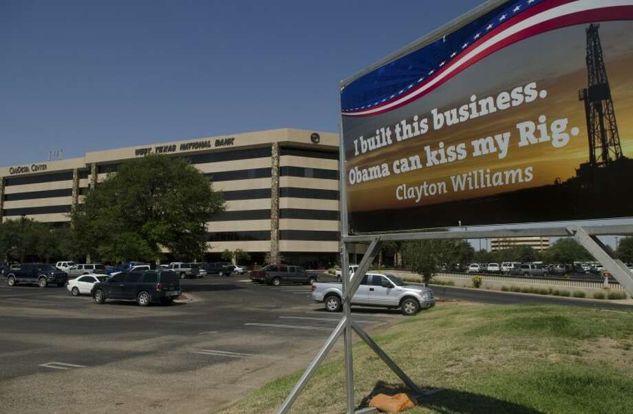 Clayton Williams has placed a sign outside Clay Desta against President Obama's business proclamations. Photo by Tim Fischer\ Reporter-Telegram Photo: Tim Fischer