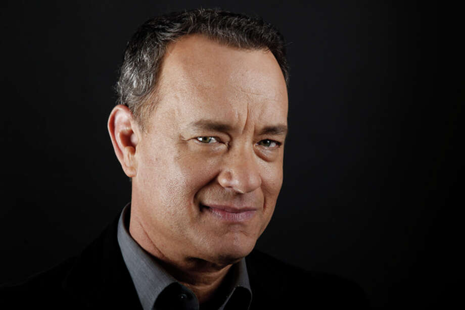 "In this June 18, 2011 photo, actor Tom Hanks poses for a portrait in Beverly Hills, Calif. Hanks stars in the upcoming film ""Larry Crowne"" which opens July 1. Photo: Matt Sayles / AP2011"