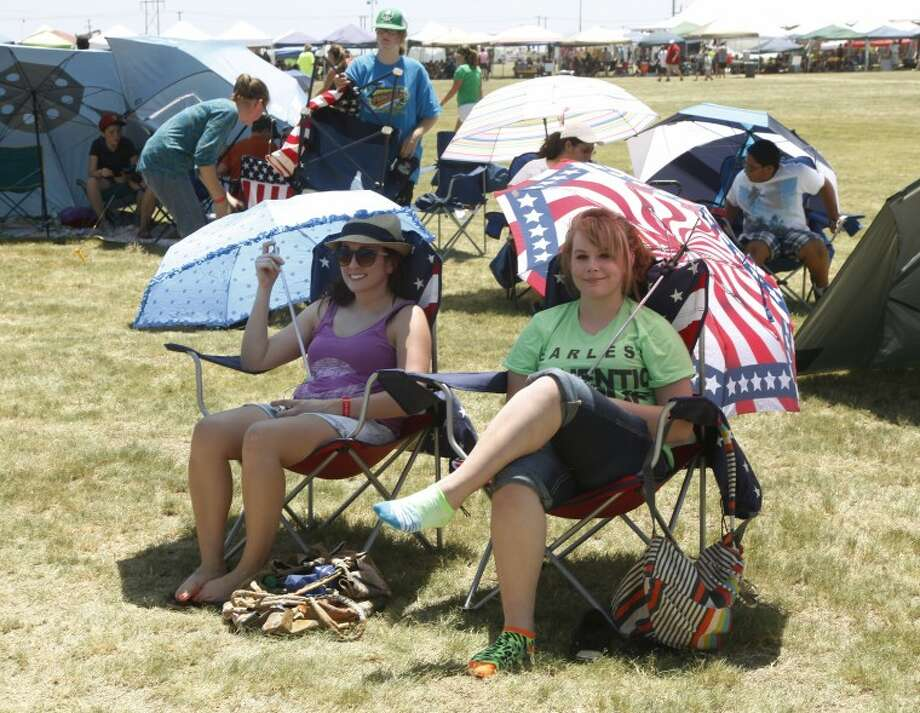 To beat the 100-degree heat many fans who went out to Rock the Desert Friday were sure to take their own shade with them in the form of umbrellas and tents. Photo: Chaney Mitchell/Reporter-Telegram