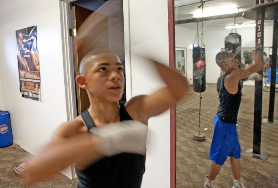 Michael Dutchover, seen here during a training session last year, won a Junior Golden Gloves title this past weekend. Cindeka Nealy/Reporter-Telegram Photo: Cindeka Nealy