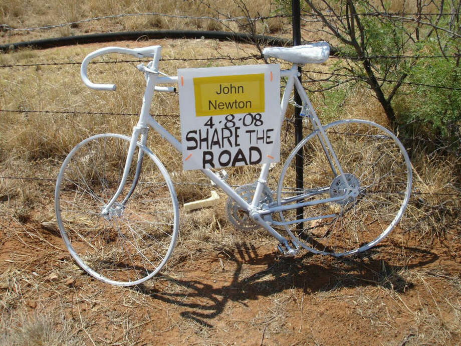 Members of the Permian Basin Bicycle Association erected ghost bikes, or roadside memorials, on Highway 191 to honor fallen bicyclists in the region. Johnny Carlos Newton, 53, died April 8, 2008, after being struck by a distracted driver. Photo: Courtesy Of Permian Basin Bicycle Association