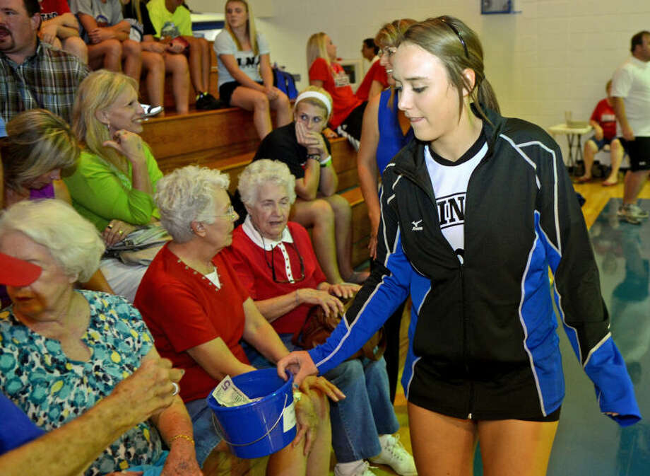 Kaitlin Hendrick of the Trinity volleyball team conducts a 'pass the hat' style fundraiser Tuesday before the start of the game against Midland Christian to raise money for Payton Hrncir, a Wink athlete who was paralyzed in an ATV accident this summer. James Durbin/Reporter-Telegram Photo: JAMES DURBIN