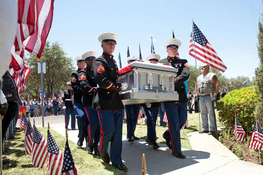 "Members of the U.S. Marine Corps honor guard carry a casket containing the body of U.S. Marine Pfc. Josue ""Yoshi"" Ibarra into the Abundant Living Christian Center, Tuesday after his arrival at the Midland International Airport. Cindeka Nealy/Reporter-Telegram Photo: Cindeka Nealy"
