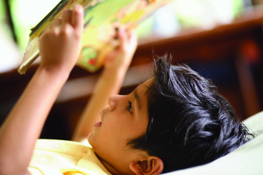 Boy Reading Picture Book Photo: Family Features / Fuse
