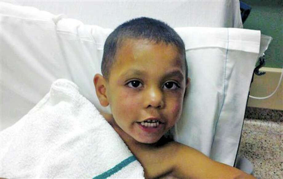 This undated photo provided by the Sweetwater (Texas) Police Department shows 4-year-old Angel Flores. Flores was found standing in the middle of Interstate 20 near Sweetwater early Tuesday, June 28, 2011. The boy's father, Carlos Rico, is in jail in Saginaw after being charged with endangering a child for reportedly abandoning the boy on the interstate. Photo: Sweetwater Police Department / Sweetwater Police Department