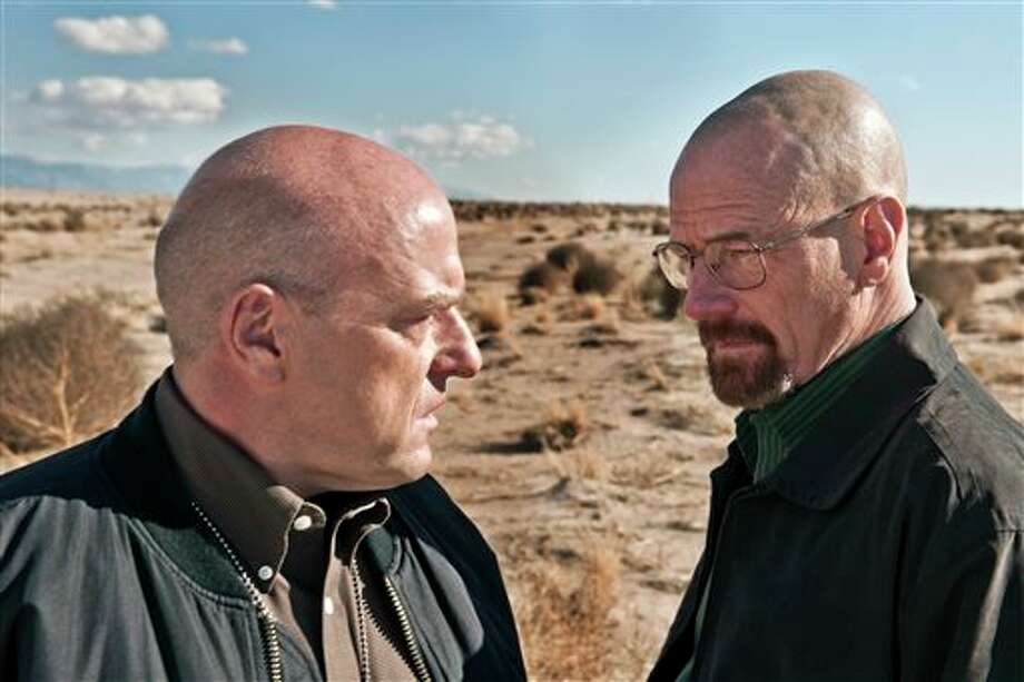 "This publicity image released by AMC shows Dean Norris as Hank Schrader, left, and Bryan Cranston as Walter White in ""Breaking Bad."" The series is returning for its eight final episodes starting Sunday at 9 p.m. EDT. The long-awaited showdown places Hank in direct conflict with the villainous hero, Walter White. (AP Photo/AMC, Frank Ockenfels) Photo: Frank Ockenfels / AMC"