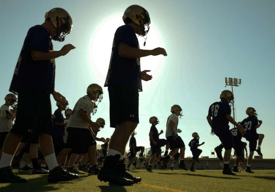Midland High players runs drills Monday during the first practice of the season. Tim Fischer\Reporter-Telegram Photo: Tim Fischer