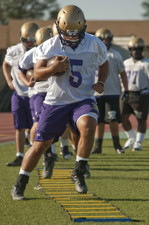 Lance White and other Midland High players run drills during the first practice of the season earlier this month. Tim Fischer\Reporter-Telegram Photo: Tim Fischer