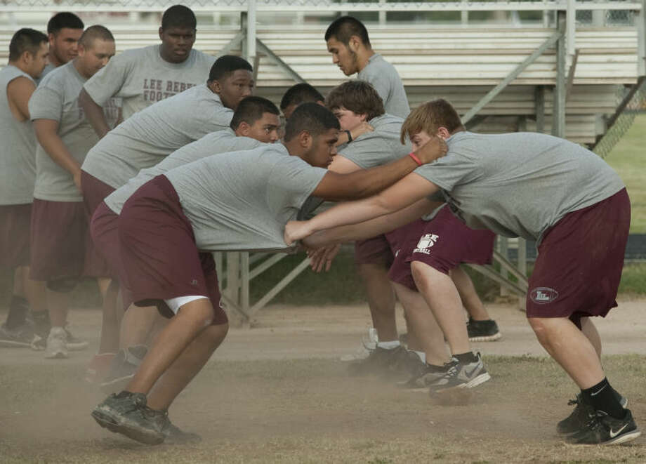Lee players run through drills Monday during the first day of football practice. Tim Fischer\Reporter-Telegram Photo: Tim Fischer