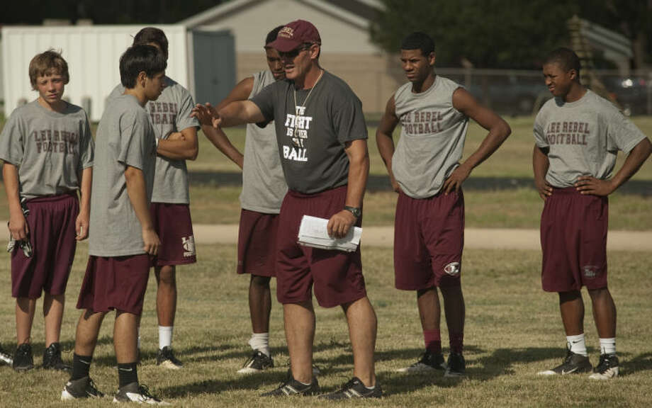 Lee coach James Morton works with players as they run through drills Monday during the first day of football practice. Tim Fischer\Reporter-Telegram Photo: Tim Fischer