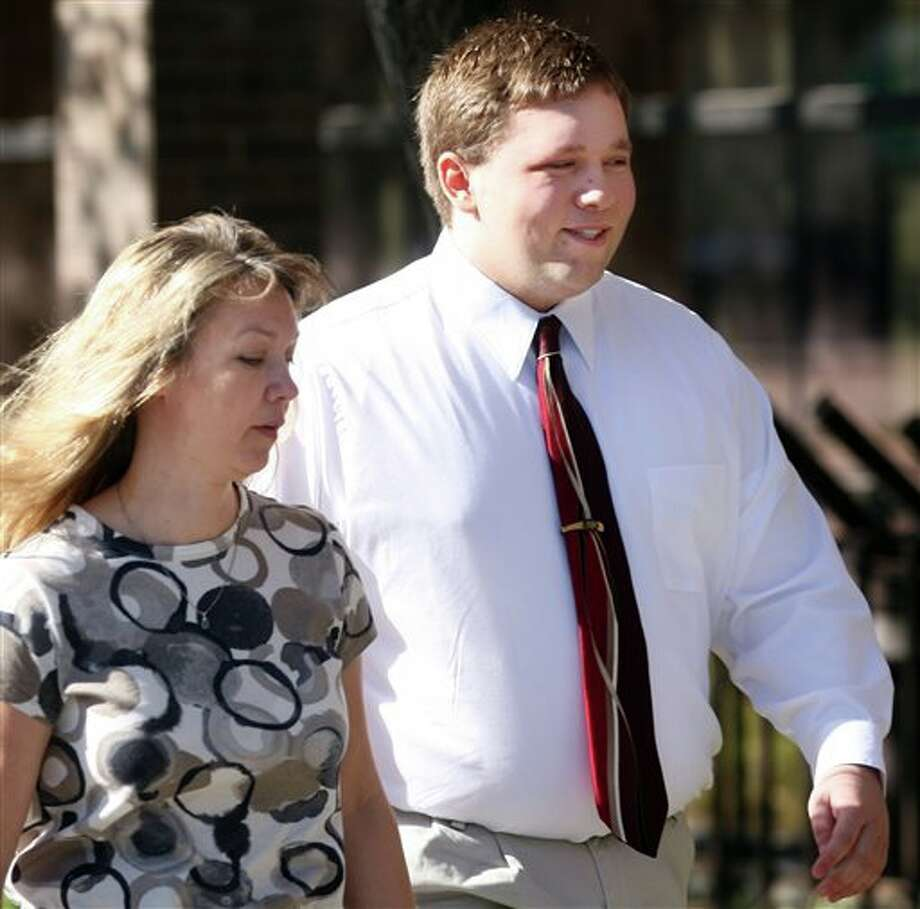 FILE - In this April 4, 2011 file photo, Roy High School bomb plot suspect Joshua Kyler Hoggan, 16, right, walks out of the 2nd District Juvenile Court in Ogden with his mother, Janice Hoggan. The Utah teenager arrested last year in a Columbine-inspired plot to blow up his high school will find out Tuesday Aug. 13, 2013 if voters in the small city of Roy will take his run for mayor seriously. (AP Photo/Standard-Examiner, Robert Johnson,File) TV OUT; MANDATORY CREDIT Photo: Robert Johnson / Standard Examiner
