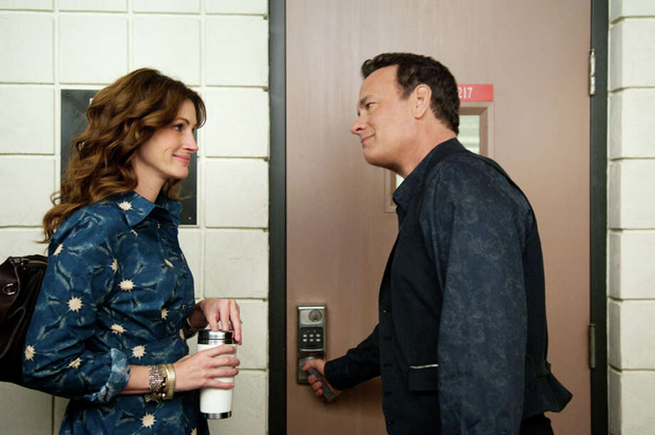 "In this film publicity image released by Universal Pictures, Julia Roberts, left, and Tom Hanks are shown in a scene from ""Larry Crowne."" (AP Photo/Universal Pictures, Bruce Talamon) Photo: Bruce Talamon / Copyright: © 2011 Vendôme International, LLC"