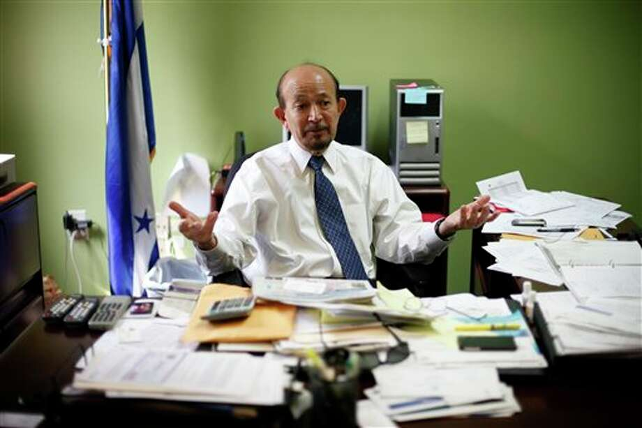 Leonardo Irias Navas, head of the Consular Section at the Embassy of Honduras in gestures in his office in Washington, Tuesday, Aug. 14, 2012. The Department of Homeland Security is releasing for the first time details on how illegal immigrants brought to the US as children can apply to avoid deportation and receive a work permit. Alejandro Mayorkas, director of U.S. Immigration and Citizenship Services, said people who qualify for the Deferred Action for Childhood Arrivals program can download the application, including forms needed to get a work permit, from the agency's website, beginning Tuesday. They can start submitting applications on Wednesday. (AP Photo/Pablo Martinez Monsivais) Photo: Pablo Martinez Monsivais / AP