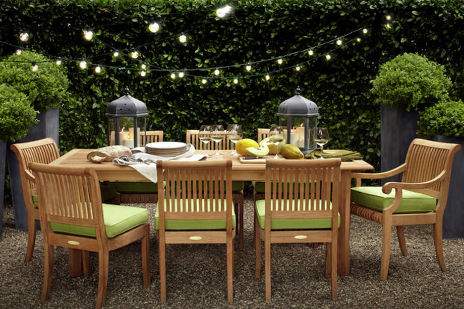 This product image courtesy of Target shows the Smith & Hawken Avignon Teak Extending table and chairs set. You don't have to deal with the mess of tiki torches to create a warm ambiance. Instead, frame your best outdoor views with string lights or paper lanterns that can range from whimsical to contemporary to sophisticated. (AP Photo/Target) Photo: HOEP / Target