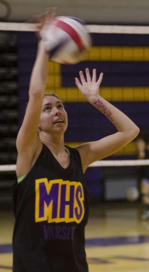 Midland High's Alexa Griggs hits Monday during volleyball practice. Photo by Tim Fischer\ Reporter-Telegram Photo: Tim Fischer