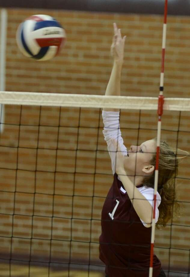 Lee's Stephanie Brewer goes up for a kill Friday against Abilene High. Photo by Tim Fischer/Midland Reporter-Telegram Photo: Tim Fischer