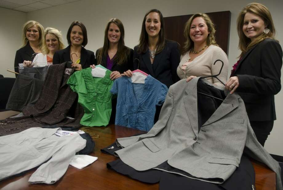 Employees at Robert Half International display some of the suits and clothing they have collected for the suit drive/donation. Photo by Tim Fischer\ Reporter-Telegram Photo: Tim Fischer
