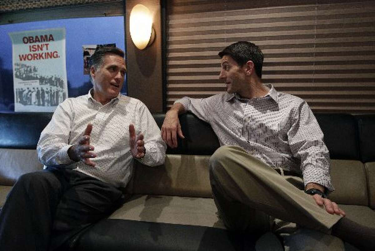 GOP presidential candidate Mitt Romney, left, and his running mate, Rep. Paul Ryan. Romney will be in Midland next week for a private fundraiser.