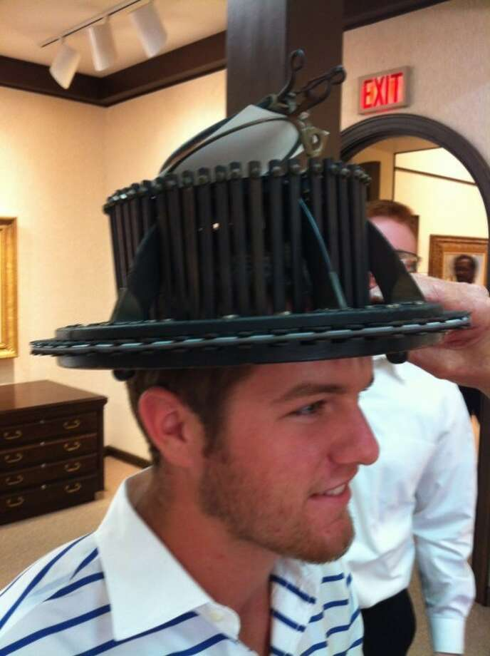 Haley exhibit: Bill Haley, son of Haley Library board vice chairman Jeff Haley, and grandson of Frances and Evetts Haley Jr., wears Jim Spradley's antique conformitor, an 1850s device used to make a custom felt hat.