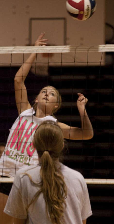 Midland High volleyball players run drills Monday. Tim Fischer\Reporter-Telegram Photo: Tim Fischer