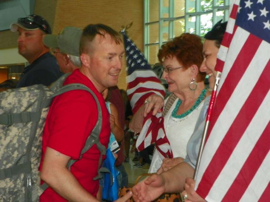 Army Sgt. 1st Class Mark Fulcher is welcomed back to Midland upon his arrival July 29 at Midland International Airport. Fulcher is a 14H-Air Defense Enhanced Early Warning Operator in Qatar. After his two-week leave he will return there and remain until May 2013. Fulcher's other deployments have been in Iraq, Korea and Bahrain. He is a 1999 graduate of Midland High School and the son of Pamela Glass and Russell Bessho and the grandson of Phyllis and Robert Glass, all of Midland. His wife, Ashley, lives in Midland. He has three children, Cade, of Lubbock, and D'Laja and Daniel, both of Midland.