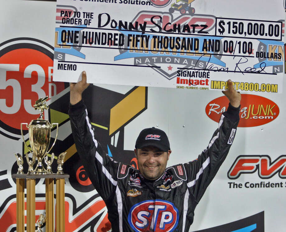 Donny Schatz holds up the $150,000 check as he celebrated after he won the A Main feature race at the Knoxville Nationals Championship Sprint Car Race at the Knoxville Raceway in Knoxville, Iowa on Saturday Aug. 10, 2013. It was Schatz's 7th victory out of 8 years at the Knoxville Nationals. (AP Photo/Des Moines Register/Bill Neibergall) Photo: BILL NEIBERGALL/THE REGISTER