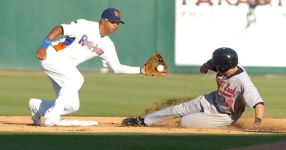 RockHounds second baseman Tyler Ladendorf (5) attempts to pick off Clay Fuller (12) as he slides onto base Thursday during their game at Citibank Ballpark. Cindeka Nealy/Reporter-Telegram Photo: Cindeka Nealy