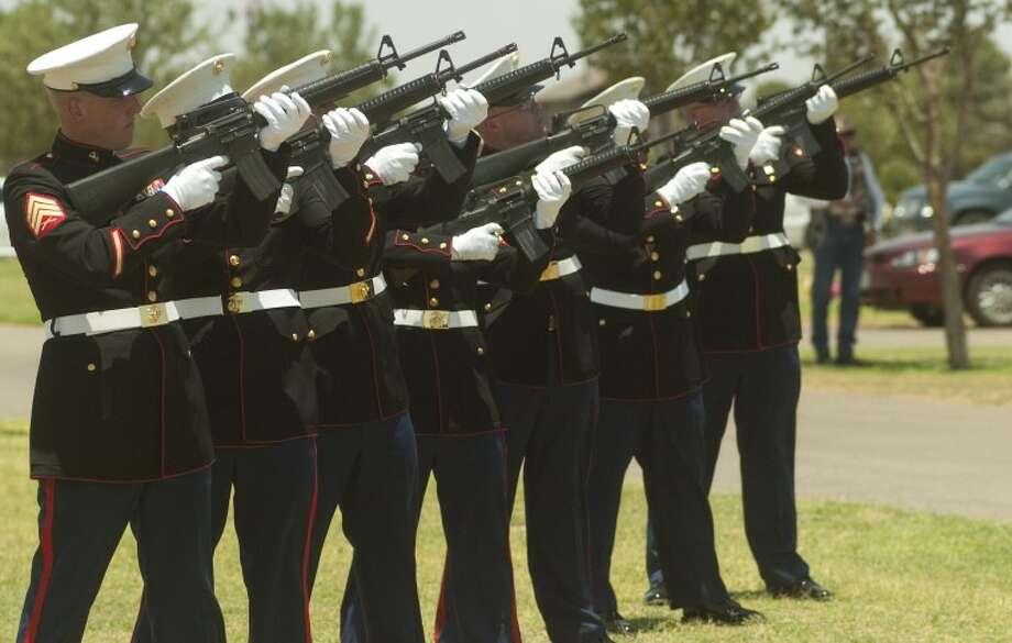 Members of the Marine Honor Guard fire a twenty one gun salute Thursday at the funeral service of Pfc. Josue Ibarra. Photo by Tim Fischer/Midland Reporter-Telegram Photo: Tim Fischer