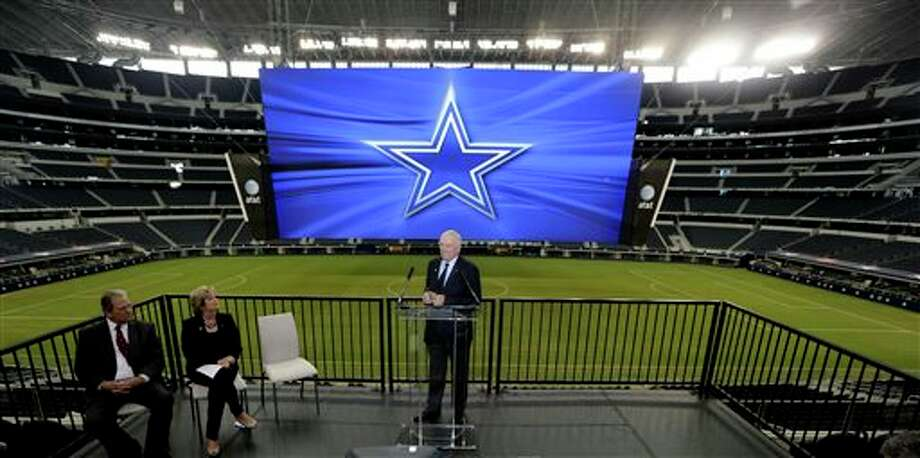 Dallas Cowboys owner Jerry Jones, right, speaks as AT&T senior vice president Cathy Coughlin, center left, and Arlington Mayor Robert Cluck look on during news conference announcing the naming of the Dallas Cowboys Stadium to AT&T Stadium Thursday, July 25, 2013, in Arlington, Texas. The terms of the naming deal were not released. (AP Photo/LM Otero) Photo: LM Otero / AP