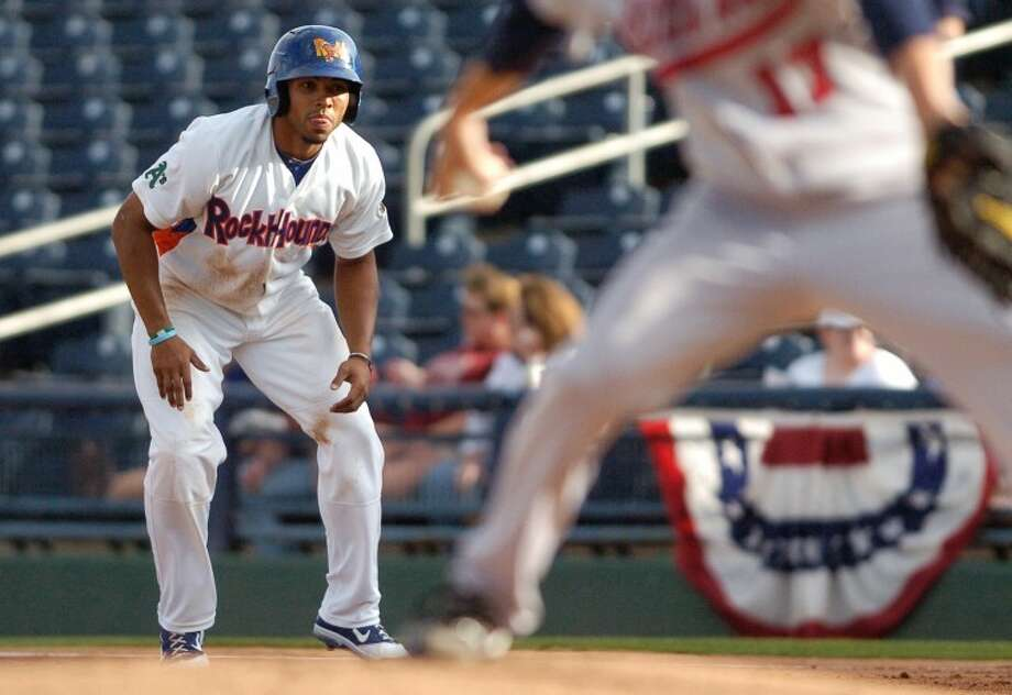 Jermaine Mitchell (25) leads off first base as Travelers pitcher Eddie McKiernan (17) prepares to throw Friday during their game at Citibank Ballpark. Cindeka Nealy/Reporter-Telegram Photo: Cindeka Nealy