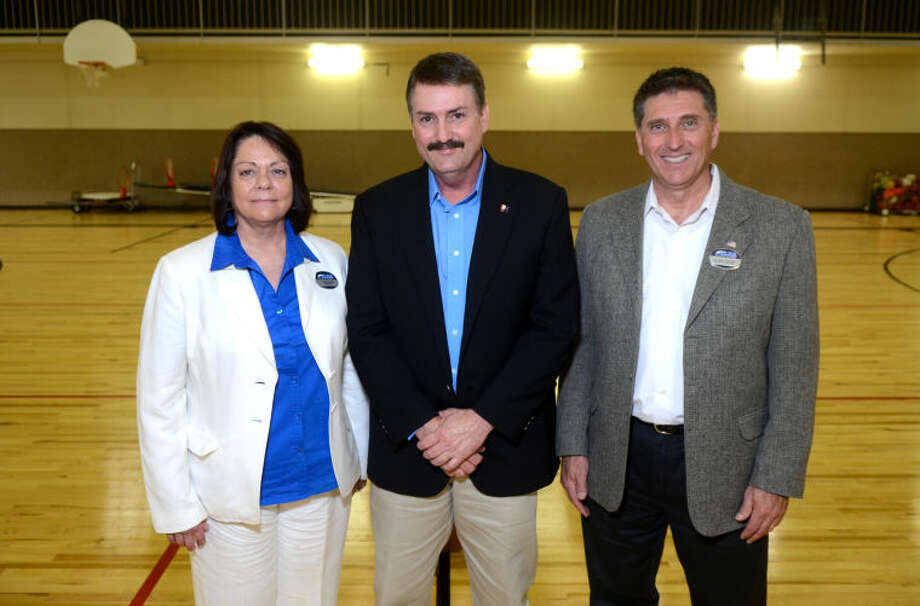 From left, Denise Rivas, TLCA Principal, Ron Ledbetter, TLCA Superintendent, and Walt Landers, TLCA CEO and founder, pose for a picture following the Texas Leadership Charter Academy of Midland press conference Tuesday at the school. James Durbin/Reporter-Telegram Photo: JAMES DURBIN
