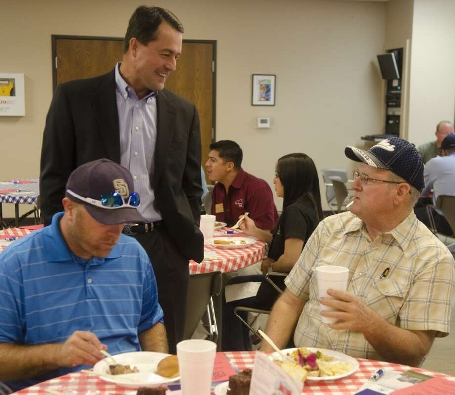 Texas Department of Agriculture Commissioner Todd Staples talks with Bryan Reed and Dave Marshall Thursday afternoon during a lunch Staples was speaking at about water conservation. Photo by Tim Fischer\ Reporter-Telegram Photo: Tim Fischer
