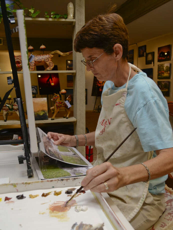 Cheryl Roush works on a painting Tuesday in an area setup inside Artizen Gallery. Tim Fischer\Reporter-Telegram Photo: Tim Fischer